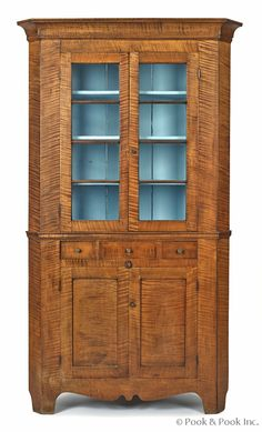 """Pook & Pook. October 11th & 12th 2013. Lot 572. Estimated: $5K - $8K. Realized Price: $14,220. Vibrant Pennsylvania tiger maple corner cupboard, ca. 1820, with a cove molded cornice over two four-lite doors, 83"""" h., 44"""" w."""