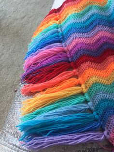 Rainbow ripple blanket with tassels. Blanket pattern from Attic24.