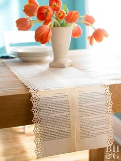 Create conversation at the dinner table with this beautifully aged runner. A discarded book with soft, worn pages works best. Lay the pages flat on the floor in the length and width you'd like your runner. On the back, carefully tape the pages together. Use a crafts decorative-edge punch to create a border that suits your style.