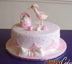 Torta rosada de la ducha de la cigüeña del bebé