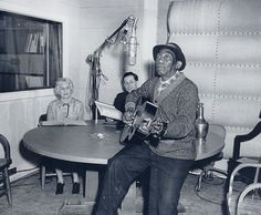 Bluesman Mississippi John Hurt, Rae Korson (left), and Joseph C. Hickerson (center), in the Library of Congress Recording Laboratory, March 17, 1964. (Library of Congress photo)