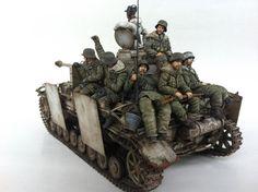 Model of Stug III, crew, and riders