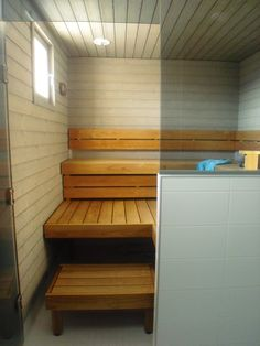 sauna,harmaa paneeli,lämpökäsitelty haapa,lauteet,saunatilat