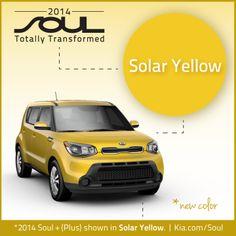 2014 Kia Soul in solar yellow.
