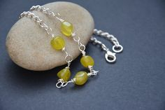 Silver and olive jade necklace. £14.00