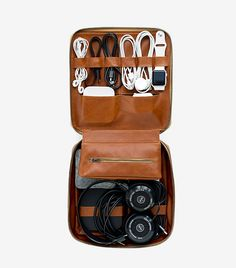 Tech Dopp Kit -- Instead of your shaving weapons and grooming goods, the Tech Dopp Kit is designed to carry your cords, cables, and technical detritus, all in one handy portable pouch. It's made of leather, features a brass zipper & is packed with compartments for all your tech trinkets.
