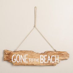 One of my favorite discoveries at WorldMarket.com: Wooden Gone To The Beach Sign