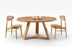 Blackbutt round dining table with tripod base. 'Seriously' comfortable Danish style chairs in American Oak