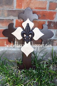 Large Dark Brown and Cream Cross topped with a wrought iron Fleur De Lis