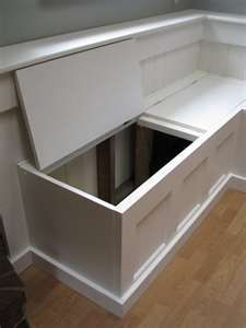banquette for dining room... Exactly what we've done: storage underneath
