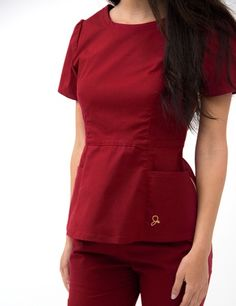 The Peplum Top in Rose Wine is a contemporary addition to women's medical scrub outfits. Shop Jaanuu for scrubs, lab coats and other medical apparel. Healthcare Uniforms, Medical Uniforms, Nursing Uniforms, Dental Scrubs, Medical Scrubs, Scrubs Outfit, Scrubs Uniform, Jaanuu Scrubs, Top Gris