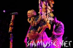 Sia on stage with patchwork wings