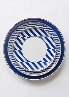 """An irresistible casual-chic dinnerware line. Distinctively decorated in  bright blue and platinum. This rich design is comprised of various  geometric shapes that blend and combine in a very New England chic style.    DIMENSIONS     * Charger Plate (12.9"""")     * Dinner Plate (11"""")     * Salad/Dessert Plate (9"""")     * Bread Plate (6.6"""")     * Soup Bowl (9.9"""")     * Cereal Bowl (6.3"""")     * Cup/Saucer Duo  DETAILS     * Porcelain / Platinum        * Made in Portugal by Vista Alegre…"""