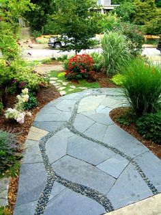 Stone path in manicured garden!  It almost looks like  there is a river flowing through the flagstone.