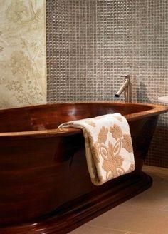 Handcrafted walnut bathtub. How cool!