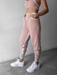 Classic tracksuit from our athleisure bestsellers! The only pair of trackies you'll ever need! Made with breathable cotton, The Horizon Pants are high waisted, complete with statement inner-thigh stripes, a front zip and the Nün Bangkok thick waistbands. Following the success of the Tank