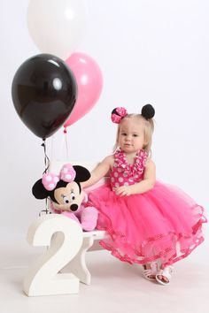 Minnie mouse birthday dress with adorable ruffle neckline.    This is a one piece, sewn dress that has a comfortable elastic back and the entire dress