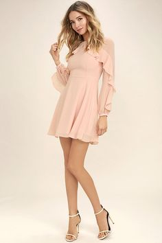 The Quiet Grace Blush Pink Long Sleeve Dress speaks volumes without saying a word! Woven poly forms a rounded neckline, and sheer decolletage, that is met by a rippling tier that travels along long sleeves (with button cuffs). Fitted bodice with princess seams tops a flaring skater skirt. Hidden back zipper.