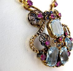 Retro Necklace ~ set with 4 faceted aquamarines, 12 rubies and 8 sapphires in a magnificent acid- tested 14k rose gold necklace ~ one of the most beautiful and distinctive pieces of estate jewelry.