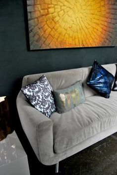 A new sofa, with some texture driven cushions and artwork.