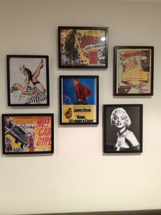 Collage of old movie posters framed on a wall in the man/people cave