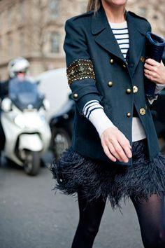 i think im liking this look- feathery skirt, stripped shirt, detailed formal coat, black tights :)