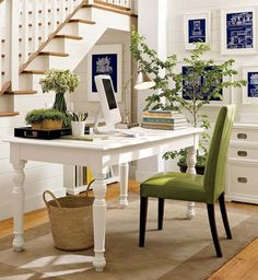 Love the classic farmhouse desk with the more modern chair. Also, great pops of cobalt blue in the decorations.