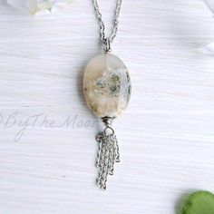 This moss agate is so gorgeous!  It has so many internal 3-D inclusions and details... it's just stunning.  Dangling from the moss agate is a tassel of stainless steel chain. $18. Click the link in my profile to go to my Etsy shop.  #handmade #etsy #jewelry #bythemoonjewelryshop #necklace #handmadejewelry #uniquejewelry #agate #mossagate #stones #crystals #gems #gemstone #tassel #pendant #boho #bohemian #gypsy #freespirit #madewithlove #goodvibes #artisan #instagood #hippie #witchy #pretty…