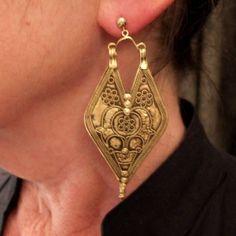 The same earings worn...