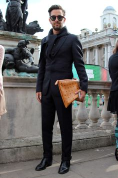 Concealed front Black suit, black scarf and tan document holder , men's street style and men's fashion