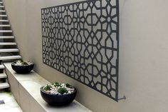 Garden Screens - geometric laser cut screen used as a wall feature, includes wall mounted feet.