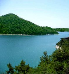 Mashkita, Syria. Lake Mashkita is a man-made lake set within densely-forested mountain slopes in the region of Latakia, and is an informal holiday destination for Syrians.
