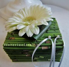 Fioreria Oltre/ Wedding ceremony/ Floral ring bearer pillow/ Gerbera daisy, snakegrass