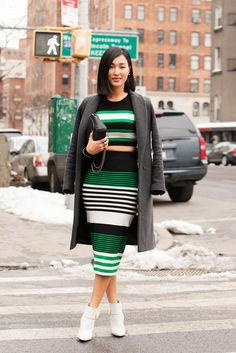 70 Looks From The Fashion Olympics #refinery29  http://www.refinery29.com/ny-fashion-week-street-style#slide43  Nicole Warne shows off a winter midriff in a hot outfit that's too good to hide behind a coat.  Jonathan Simkhai Cross Over Knit Crop Top, $275, available at Forward By Elyse Walker; Jonathan Simkhai Striped Knit Skirt, $345, available at Forward By Elyse Walker;