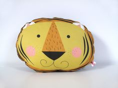 "Home and Decoration.  Small animal cushion ""Tiger"" yellow. The ava&yves cushions are produced by ""proWerk Bethel"", an organisation for handicapped people. Size of the cushion: ca. 25x21x10cm. Material: front: 100% cotton, back: 60% polypropylen, 30% wool, 10% viscose. Filling:  100% polyester Oekotex100, handwash recommended.  20,00 € incl. VAT plus shipping."