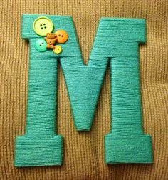 The letter I decorated for Baby Michael. Nursery for sure. Letter decorating with yarn and buttons.