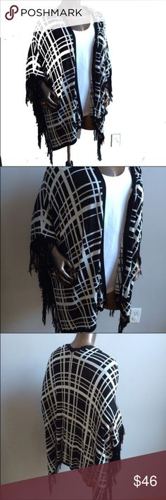 BRAND NEW Black White Plaid Fringe Poncho Sweater Item: Black & White Plaid Print Fringe Poncho  Condition: Brand new with tags  Color: Black & White  Size: Small, medium, large & XL available Sweaters Shrugs & Ponchos