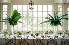 """Envisioning what a wedding would look like in the tropical locale, she pulled in """"the rich and bold greens through varying types of palm and mixing creamy ivories"""" to capture..."""
