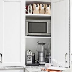 This appliance garage goes vertical by using space from countertop to ceiling to store the most commonly used appliances. If the coffeemaker or coffee press are used every morning, store coffee beans and sugar close by./