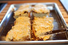 Garlic Cheese Bread  (Pioneer Woman): also 2 c Monterey Jack cheese, 3/4 c ranch, 2 T melted butter.  Brush with melted butter and broil 4 min.  Spread with cheese mix and bake @ 350 10-15 min or til cheese melted.  Sprinkle with parsley