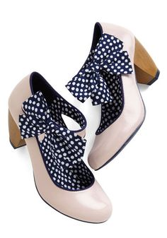 While awaiting your arrival, your pals discuss your fab fashion sense, then as if you were waiting offstage, you stroll in showcasing the pale pink hue of these glossy Mary Janes heels. Admiring smiles affirm that you've done it again by perfecting an ensemble with these navy and white bow-bedecked heels!