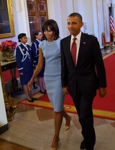 The Obamas!!  Mrs. O is wearing a Michael Kors Surf Stretch Boucle Crepe Sheath dress with pearls and neutral pumps.