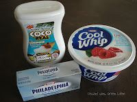 Coconut Cream Fruit Dip  4 oz cream cheese 1/2 (15oz) can Cream of Coconut (Not coconut milk! Find this in the aisle with the margarita mix & other mixers.) 1/2 (8oz) tub Cool Whip  Whip the cream cheese with the cream of coconut in a stand mixer until all lumps are gone. Remove paddle, & fold in cool whip. Serve with fruit or graham crackers.
