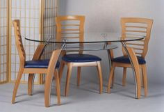 """Complete 5 PCS. Set Laddis oval dining room set - Model# KD138L by Chans E Shop. $595.00. Wood Construction with Lite Birch Liminated Finish. Price for Set of 4 PCS and 1 Dining Table. Dimension: 58""""L x 35""""W x 29""""H. Assenbling Required. Soft Foam Cushion Available in Blue or Beige. This cozy four-seater is complete with one layer of frosted glass and a large oval tempered glass top. Price also includes a set of four chairs, available in beige or blue cushions...."""