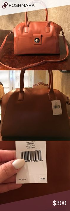 Brand New Kate Spade Large Brown Purse Large leather tote in a medium brown. Never used still has tags. Has a cute front pocket outside of the purse and 2 pockets on the inside. Lots of room. Also comes with a crossbody. Has gold accenting kate spade Bags Totes