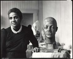Selma Burke, American sculptor, 1900-1995, in her studio. She was one of the few African-American women sculptors who achieved a high level of national recognition during her lifetime. She received national recognition for her relief portrait of Franklin Delano Roosevelt which was the model for his image on the dime. She was committed to teaching art to others, so she established the Selma Burke Art School in New York City and opened the Selma Burke Art Center in Pittsburgh, PA.