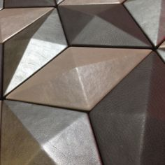 Harcourt London: Diamond Three dimensional leather tiles.