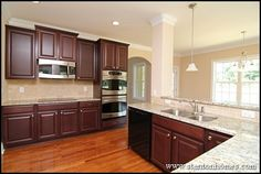 Light Counters. Dark Cabinets. Stainless appliances and silverish finishes on fixtures.  | New Home Kitchen Design