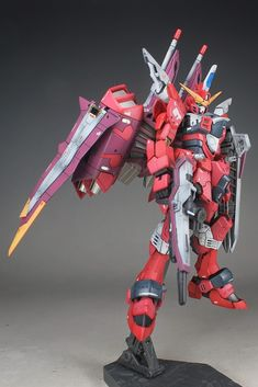 RG 1/144 Justice Gundam Painted Build by schorst One amazing thing about this painted kit is its presentation. The modeler did a fantasti...