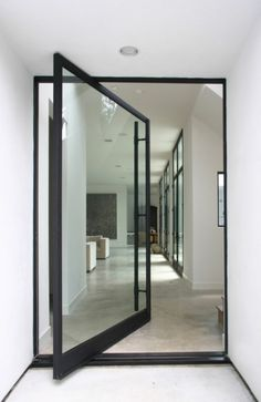 Love the concrete floor, the white walls and the black frames of the windows and doors.